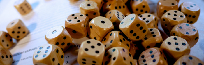 Image of dice on an open book.