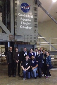 Visitors pose in front of the High-Capacity Centrifuge at NASA Goddard Space Flight Center