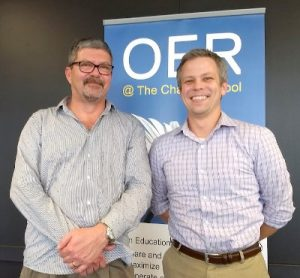Candid photo of Wayne Mackintosh from the OER Foundation and Sean Connor from Saylor Academy